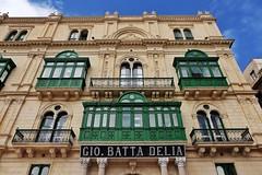 Gio. Batta Delia (Douguerreotype) Tags: green city historic shop balcony buildings window malta architecture valletta sign