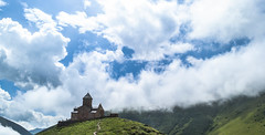 Facing the Clouds (MikeTheExplorer) Tags: gergeti gergetichurch kazbegi georgia caucasus asia caucasusmountains church temple clouds cloudy cloudyday color colorful colors light contrast composition architecture mountain mountains travel traveling traveler wanderlust explore discover
