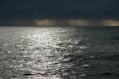 rideaux de pluie (Mireille Muggianu) Tags: bouchesdurhone europe france laciotat provencealpescotedazur bateau boat ciel mer paysage pluie voilier samsung nx nx500