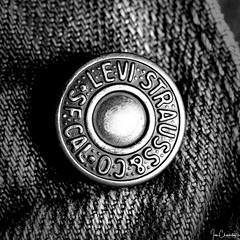 Circle Gets the Square (Ian Charleton) Tags: macromondays centersquarebw button jeans levis levistrauss clothing denim blackandwhite bw monochrome squarecrop centercomposition symmetry fabric metal