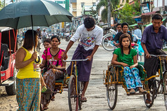 Dueling Trishaws (shapeshift) Tags: asia bicycle burma candid davidpham davidphamsf documentary myanmar people rakhine rakhinestate shapeshift shapeshiftnet sittwe southeastasia street streetphotography transport transportation travel trishaw trishaws umbrella myanmarburma mm