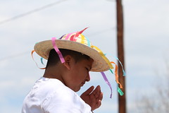 Christian Canales tries on a hat from one of the dance costumes. He loves dancing and spending time with his friends and family.