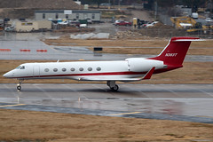 Gulfstream G-V (DPhelps) Tags: kdal dal dallaslovefield texas love airport aircraft airplane plane jet airliner propeller spotting rain fog mist weather ice overcast runway garage g550 gulfstream aerospace gv n383t target corporation minneapolis