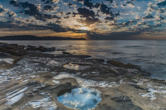 Sunrise Seascape with Clouds and Reflections in the Rock Pool (Merrillie) Tags: daybreak sunrise cumulus nature dawn earlymorning coast water morning sea newsouthwales rocks pearlbeach nsw rocky waterscape ocean rockpool landscape waves coastal clouds outdoors seascape australia centralcoast sky seaside