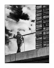 La vigie. (francis_bellin) Tags: málaga andalousie streetphoto street homme barbe photoderue nuages immeuble noiretblanc monochrome ciel hiver immeublelecorbusier rue janvier bw 2019 blackandwhite espagne
