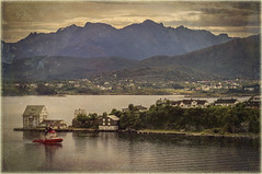 Early Morning Alesund(Norway) (williamwalton001) Tags: pentaxart norway artwork architecture colourimage clouds colours trees texture timber buildings boats mountains water woodlands trolled