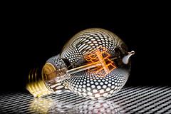 Light (hjuengst) Tags: light licht glühbirne lightbulb abstract perforateplate lochblech reflection art spiegelung hjuengst nikon