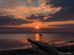 _1200043 (Paul_sk) Tags: winter sunset shoeburyness essex river thames beach mud boats clouds sun sky southendonsea