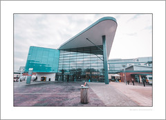 The Royal Derby hospital (G. Postlethwaite esq.) Tags: canon40d derby derbyshire royalderbyhospital sigma1020mm architecture building glass mainentrance people photoborder wastebin wideangle windows sliderssunday hss