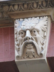 Scroll Face Green Man Gargoyle Above Doorway 4597 (Brechtbug) Tags: scroll face greenman gargoyle above doorway building facade 8th avenue west 21st street nyc 11112018 new york city midtown manhattan 2018 gargoyles portraits monster portrait monsters creature faces spooky art architecture sculpture keystone mask brownstone brown stone capital fall winter autumn creeped out scrolling mustache