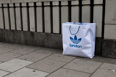 Adidas, Bag, London - 20180711-IMG_4215 (roger_thelwell) Tags: mayfair oxford circus uk london beautiful street photography bw black white portrait people urban city commuters winter cold hat hats mobile phone cell england hair fleet strand life natural walking talking conversation chat speak speaking beauty handbag stud studs lamppost lamp post shiny shiney leather smoking cigarette westminster traffic cab taxi bag sac shoulder mono monochrome great britain streets photographs real photographic photos candid rain umbrella group