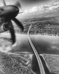 Takeoff (ahockley) Tags: i205 glennjacksonbridge motionblur blackandwhite transportation travel airplane takeoff vanwa vancouverwashington washington vancouver oregon pdx portland horizonair q400 bombardier alaskaairlines iflyalaska