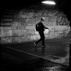 Under the spotlight (pascalcolin1) Tags: paris13 homme man nuit night pluie rain lumière light projecteur spotlight mur wall tunnel chanel capuche photoderue streetview urbanarte noiretblanc blackandwhite photopascalcolin 50mm canon50mm canon carré square hood