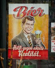 Beer helps against acute reality! (RickB500) Tags: poster plakat beer bonn street