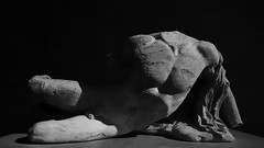 Reclining naked Hellenic youth.. (edk7) Tags: olympusomdem5 slrmagic8mm14rectilinearultrawideanglemanualfocuslens edk7 2018 uk england london bloomsbury britishmuseum elginmarbles parthenonmarbles athens acropolis parthenon athensacropolisparthenonwestpedimenthighreliefmarblesculpturec440bce recliningnakedyouth sculpture stonecarving temple monument ancient greek greece nude male