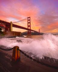 Splash! (wuman88) Tags: golden gate bridge san francisco ggb sf coast waves splash sunrise fort point ocean shore