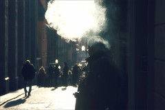 Puff of smoke (*Kicki*) Tags: stockholm gamlastan sweden oldtown fotofikapromenad autumn smoke people backlight street smoker bokeh city man