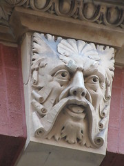 Scroll Face Green Man Gargoyle Above Doorway 4601 (Brechtbug) Tags: scroll face greenman gargoyle above doorway building facade 8th avenue west 21st street nyc 11112018 new york city midtown manhattan 2018 gargoyles portraits monster portrait monsters creature faces spooky art architecture sculpture keystone mask brownstone brown stone capital fall winter autumn creeped out scrolling mustache