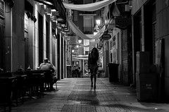 Night in B&W (Daniel Nebreda Lucea) Tags: street calle city ciudad night noche noir atmosphere atmosfera dark darkness oscuro oscuridad light luz streets calles alley callejon life vida nightlife people gente walking andando canon 60d 50mm composition mood motion movimiento urban urbano black white blanco negro monochrome monocromatico enjoy zaragoza spain old viejo antiguo lights shadows sombras shadow perspective perspectiva