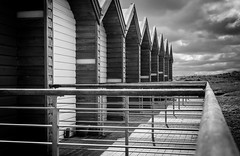 Beach Huts and clouds (Marc Bates Photography) Tags: blyth britain england northeast northumberland seasideholidays uk architecture background beach beachhuts beachside blackandwhite bright cabin clouds coast coastline day door grass handrail holiday home house hut huts landscape mono outdoor roof roofline row seafront seascape seaside sky skyline stormy sunny tourism vacation vacationhomes wood wooden