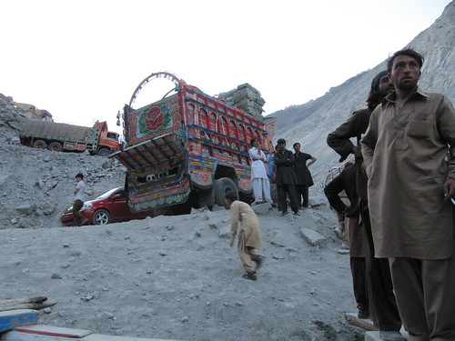 Pakistani men wait to unload trucks at Attabad Lake. Gilgit-Baltistan, Pakistan.