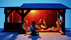 Nativity (fillzees) Tags: nativity birthday wooden model figurine baby king shepard sheep donkey toy mother father parents stilllife tabletop desktop animal barn person boy man costume handcrafted homemade stable beam timber shadow backlighted silhouette