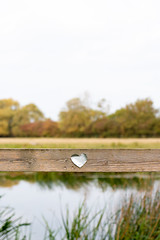 Fence of Love (oandrews) Tags: autumn autumnwatch building buildings cambridgeshire canon canon70d canonuk cloud clouds fendrayton fendraytonlakes heart landscape love nature naturereserve outdoors reflection reflections ripples rspb sky tree trees water cambridge england unitedkingdom gb