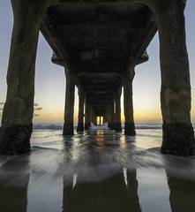 Under The Pier (Tom Yessis) Tags: canon canonphotography color coast sky sunset seascape sea sunshine shadows pier manhattanbeachpier manhattanbeach water wideangle waves longexposure landscape losangeles