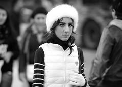 Snow White (Stuart Mac) Tags: portrait street mono d700 135mm candid winter fur hat gloves cold woman