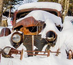 Buried In Rust and Snow (John Kocijanski) Tags: rust car automobile vehicle snow winter abandoned canon18135mmstmlens canon7d
