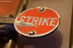 Strike To Sound Alarm (Retro Photo International) Tags: fire safety door alarm macro macromondays carl zeiss jena 50mm 35 emergency exit lock