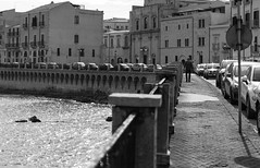 The Walk (LeeDylanLeeDyl) Tags: walk walking old bw black white syracuse syracusa ortygia ortigia italy italia europe european d3300 35mm 18 ocean sea seaside shadows