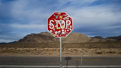 Stop sign outside Area 51. Nevada, USA. (@letsseephotos) Tags: area51 ufo ovni alien sky clouds desert mountains nature road stickers sign blue red brown adventure exploration