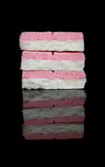 2019 Sydney: Coconut Ice (dominotic) Tags: 2019 food coconutice confectionery reflection blackbackground foodphotography pink white yᑌᗰᗰy sydney australia