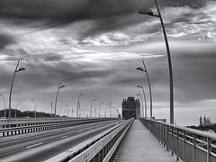 The bridge (Zoom58.9) Tags: sky clouds bridge lamps street building steel europe germany sony himmel wolken brücke lampen srasse gebäude stahl europa deutschland monochrome bw landscape landschaft sun sonne