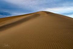 Great Dune (TierraCosmos) Tags: sand sanddunes mesquiteflat deathvalley deathvalleynationalpark california landscape clouds ripples dune desert peak