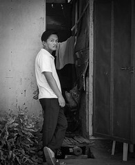 Expression (Beegee49) Tags: street man standing expression black white monachrome bw doorway staring luminar happy planet sony a6000 silay city philippines asia