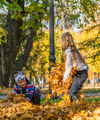 Kids Playing with autumn leaves in Autumn Park (AudioClassic) Tags: autumn fall child happy park nature girl fun people season kid cute beautiful yellow person young joy outdoor smile caucasian playful leaves portrait childhood orange foliage happiness colorful little outside leaf laughing positive family maple forest seasonal small boy day playing golden lifestyle pleasure fashion tree october two face outdoors active friends leisure kids together jumping