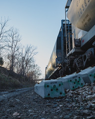 Ground level (◀︎Electric Funeral▶︎) Tags: omaha midwest councilbluffs nebraska lincoln fremont desmoines kansascity kansas missouri iowa graff graffiti paint aerosol art freight train traincar freighttraingraffiti railway railroad railcar benching benched freighttrain rollingstock fr8train fr8heaven fujifilmxt2 digital photography