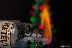 Redux 2018 (Digifred.nl) Tags: macromondays redux2018 digifred 2018 nederland netherlands pentaxk5 hmm macro macrophotography closeup fles vlam kerstbokeh bokeh bottle flame holidaybokeh
