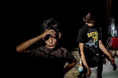 Eye Contact-DSC_9265 (thomschphotography3) Tags: israel jerusalem boys children batman portrait dark light shadow streetphotography