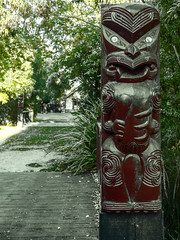 The Carved Guardian (Steve Taylor (Photography)) Tags: guardian art sculpture carving green selectivecolour wood newzealand nz southisland canterbury christchurch trees maori rehuamarae richmond warrior