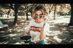 Klaudia (KenjisShotBook) Tags: ifttt 500px sunglasses active alone park recreation leisure brunette pensive tamagawa river blond shorts sun visor czech canon sigma kenjisshotbook inspiration mood cinematic movie popular lifestyle portrait lookslikefilm headshot modern life beauty travel photography