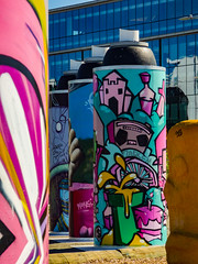 Painted Cans (Steve Taylor (Photography)) Tags: jackem wongi bottle wheel candle cake stereo castle sword boombox hand can graffiti mural streetart building office window colourful newzealand nz southisland canterbury christchurch cbd city aerosol paint shape