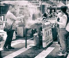Photographing Turkey Drums (Demmer S) Tags: photographer festival marketplace fair vendors food turkeydrums outdoors refreshments turkeylegs festive arts crafts snacks sign ad words signage type text street streetphotography people peoplewatching shootthestreet streetlife streetshots documentary candid candidstreet citylife person urban city outside urbanphotography streetscene urbanexploration ny newyork nyc newyorkcity manhattan eastcoast downtownmanhattan downtownnewyork financialdistrict bw monochrome blackwhite blackandwhite blackwhitephotos blackwhitephoto vendor selling streetvendor