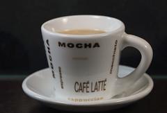 Brewed coffee with cream (Millie Cruz) Tags: brew macromondays coffee cream brewed cup macro ceramic plate white canoneosrebelt6i ef100mmf28lmacroisusm café