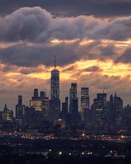 Lower Manhattan (johnbacaring) Tags: nyc architecture newyorkcity manhattan oneworldtrade wtc sunrise clouds canonphotography tamron150600mm tamron canon buildings neatgeoyourshot natgeo city lowermanhattan citylife