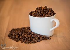 More than enough (GunnarImages (Gunnar Haug)) Tags: spill brown cup coffeebeans beans full plenty brazil bean coffee fullerton overfilled arabica oak white