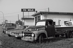 70 Mile (Curtis Gregory Perry) Tags: britishcolumbia 70milehouse ford truck meteor car old classic vehicle bw black white monochrome nikon d810 highway 97 canada canadian bc sign automóvil coche carro vehículo مركبة veículo fahrzeug automobil