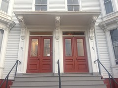 790 and 792 Congress Street (Bracketed Hoods) Tags: 2015 bracket maine architecture bracketedhood doorway portlandmaine 790congressstreet 792congressstreet congressstreet shells scrolls grooves acanthus dots double doors twindoorways transomwindow triplets quatrefoils floral